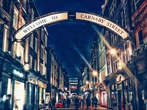 A shopping street in london. A famous street of shopping in london by night Stock Photography