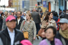 Shopping Street in London. People walk along a busy shopping street in Chinatown on May 30, 2015 in London, UK. Over 120,000 people of Chinese ethnicity live in Stock Image