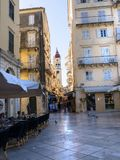 Shopping Street in the main town on the the Greek island of Corfu. The city of Corfu stands on the broad part of a peninsula, whose termination in the Venetian Royalty Free Stock Image