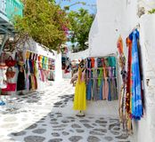 Shopping street at Mykonos. Colorful dress and Scarf. Greece. Europe royalty free stock photography