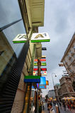 Shopping street neon signs consumerism Stock Image
