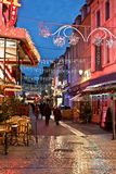 Shopping street at night with Christmas lights. Decorations, Trouville, France Royalty Free Stock Image