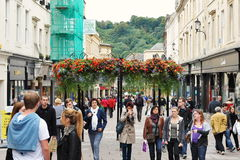 Shopping Street. People walk along a busy shopping street on October 4, 2012 in Bath, UK. Bath is a UNESCO World Heritage city and popular travel destination Stock Photos