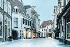 Shopping street with snowfall in the Dutch city center of Zutphen royalty free stock images