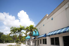 Shopping Strip Building. Shoping strip mall entrance detail,colorful awnings in tropical setting Stock Photos