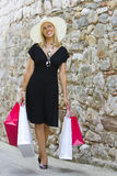 Shopping With Style. A stunningly beautiful wealthy young blond woman shopping in Europe with plenty of style Stock Images