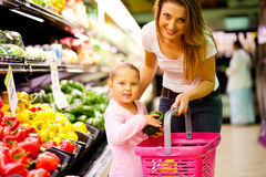 Shopping in supermarket royalty free stock images
