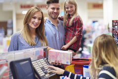Shopping at the supermarket. Family packing shopping at supermarket checkout Stock Photo
