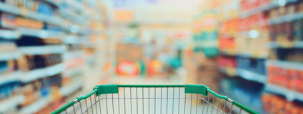 Shopping in Supermarket with shopping cart Stock Photos