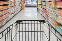 Shopping in supermarket with trolley Royalty Free Stock Images