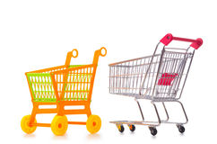 Shopping supermarket trolley. The shopping supermarket trolley isolated on the white Royalty Free Stock Photos