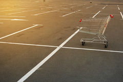 Shopping supermarket trolley. On the sunny parking Stock Images