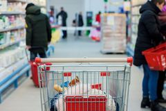 Shopping in a supermarket. Woman buys fruit and dairy product. stock photo