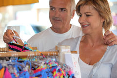Shopping for a swimsuit. Woman shopping for a swimsuit Royalty Free Stock Photo