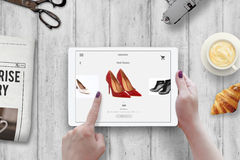 Shopping with tablet. Woman buy red shoes on online market Stock Photography