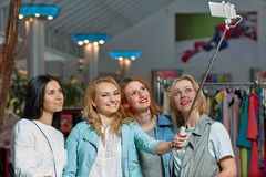 Shopping and taking selfie. Beautiful girls with shopping taking a selfie with their cell phone stock photo