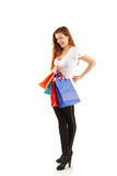 Shopping teen girl holding bags Stock Image