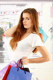 Shopping teen girl smiling holding bags Royalty Free Stock Photos