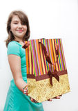 Shopping teen girl smiling holding shopping bags. Stock Photo