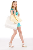 Shopping teenager happy woman in summer dress. With paper bag Stock Images