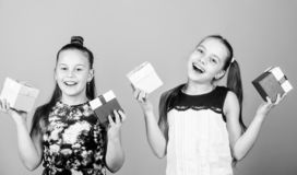 Shopping is their passion. children. Little sisters with gift. Small girls with present box. Surprise. Family sisterhood stock images