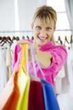 Shopping therapy. Young woman on shopping spree Royalty Free Stock Images