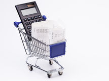 Shopping till receipt calculator and cart. Shopping till receipt, calculator and cart concept for grocery expenses Stock Image