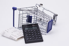 Shopping till receipt calculator and cart Stock Photography