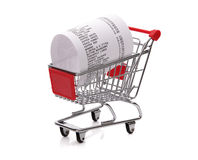 Shopping till receipt in cart. Concept for grocery expenses and consumerism Stock Photography
