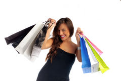 Shopping time. Beautiful young woman holding shopping bags isolated on white Stock Photo