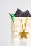 Shopping time. Christmas shopping bag stuffed with candy canes Royalty Free Stock Image