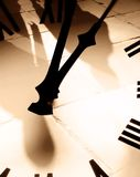 Shopping time. Shadows of high street shoppers overlaid on to clock face Royalty Free Stock Photography