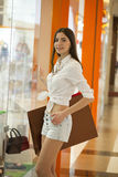 Shopping time, attractive woman at mall Royalty Free Stock Photography