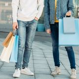 Shopping time couple casual leisure legs bags royalty free stock photo