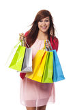 Shopping time. Fashionable young woman with shopping bags Stock Photography