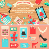 Shopping time vector illustration. Online shopping concept desktop with smartphone, table, shopping bags, credit cards, coupons and products. Set of flat design Stock Image