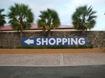 Shopping to the left. A big 'shopping' sign with direction arrow in the street Stock Photography