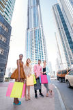 Shopping together. Four friends holding shopping bags in their h Stock Photo