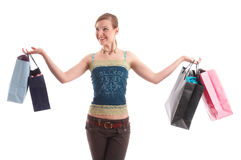Shopping tour. A happy woman is presenting her shopping bags after successful  bargain deals Stock Photo