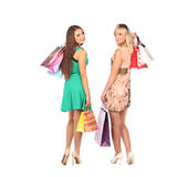 Shopping and tourism concept - beautiful girls with bags Royalty Free Stock Image