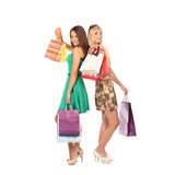Shopping and tourism concept - beautiful girls with bags Stock Image