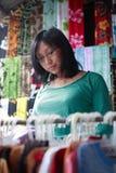 Shopping at Traditional Asian Market. Woman shopping souvenirs at local market in Bali Stock Photography