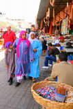 Women walking through market Royalty Free Stock Image