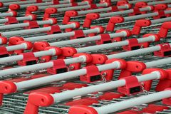 Shopping troleys. Parked shopping trolleys, red and grey color Stock Photos