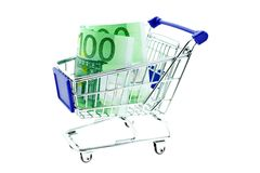 Shopping trolley with 100 euro notes isolated. On white background Stock Photos