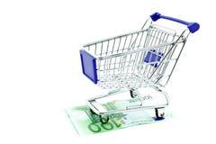 Shopping trolley on 100 euro notes isolated. On white background Stock Image