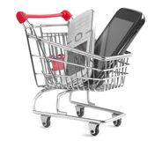 Shopping trolley. With cell phones isolated on white background Royalty Free Stock Photography