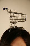 Shopping trolley. Empty shopping trolley in silver on top of a head Stock Photography