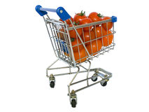 Shopping trolley. Filled with tomatoes on a white background Stock Images