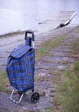 Shopping trolley bag. Blue shopping trolley bag keeping outdoor Stock Image